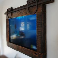 Hanging Tv ,Barn Door Style by Terence Dolan