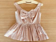 Miu Miu Pink/ Salmon colored Bow Top Size zip closure cotton Size Note: little sawing needed at end of zip closure see picture Bow Tops, Salmon Color, Closet Designs, Zurich, Marie Antoinette, Miu Miu, Trending Outfits, Rompers, Bows