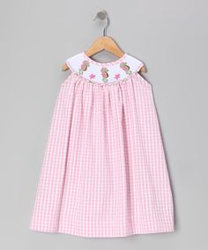 As timeless as it is effortless, this darling dress slips right on with its breezy swing cut, gingham fabric and buttons in back, while the stylish yoke neckline boasts beautiful smocking and embroidery. 100% cottonMachine wash; tumble dryImported