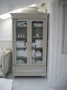 Perfect Repurposed Glass Front Armoire Is Used For Storage In The Bathroom   Full  Bloom Cottage. Bathroom StorageBathroom CabinetsBathroom Linen ...