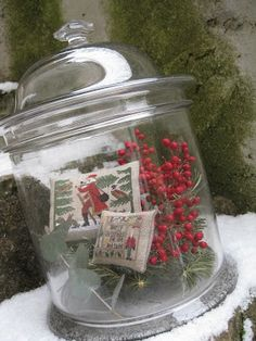 """great idea for christmas: fill a glass jar with Christmas stitched """"pillows"""". I like."""