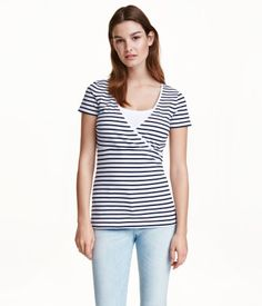 White/dark blue striped. CONSCIOUS. Short-sleeved nursing tops in organic cotton jersey with wrapover front and practical inner top for easier nursing.