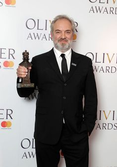 """Sam Mendes - winner of the Best Director Award for his work in the Jez Butterworth play """"The Ferryman"""" - poses for the press backstage at the Laurence Olivier Awards - April 8, 2018.  The play which tells the story of the family of a former IRA activist, living in their Ireland farmhouse in 1981 was moved to Broadway in October, 2018.  There it would win four Tony Awards, including another directing award for Mendes. Columbus Georgia, Sam Mendes, Best Director, Henry Shaw, Suit Jacket, Butterworth, Poses, Backstage, Ireland"""