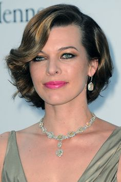 Milla Jovovich swaps red lipstick for a cheerful pink shade for her red carpet look. We love the bronzed smoky eye make-up and subtly sun-kissed cheeks. Celebrity Gallery, Celebrity Photos, World Most Beautiful Woman, Teresa Palmer, Milla Jovovich, Gorgeous Eyes, Jessica Chastain, Charlize Theron, Nicole Kidman
