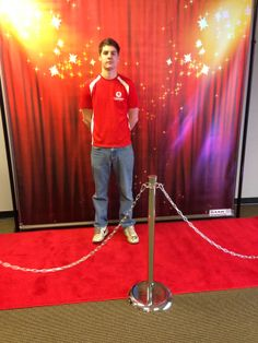 Here is one of our Hollywood themed backdrops 8'x8' with red carpet, stanchions and black ropes. We have over 20 different colored carpets to match your banners and several different options for ropes. We also have 8'x10' banners available.  Please give us a call on how we can make your need event special.