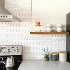 Whether your kitchen is rustic and cozy or modern and sleek, we've got backsplash ideas in mirror, marble, tile, and more. Find and save ideas about Kitchen splashback tiles in this article. Kitchen Redo, Kitchen Tiles, New Kitchen, Kitchen Remodel, Kitchen Splashback Ideas, Hexagon Tile Backsplash, White Kitchen Backsplash, Hex Tile, Penny Tile