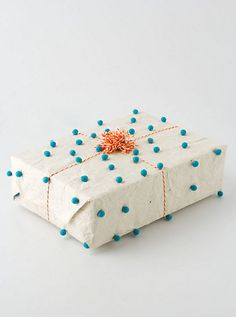 Love the idea of gluing pompoms on plain paper #giftwrap