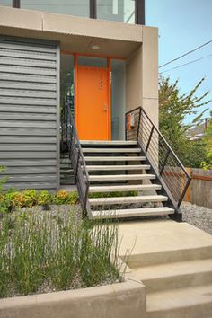 Front Door Color:)Make a bold entrance. If your front door is less than perfect, why not give it a fresh lick of paint? You will want to coordinate the hue with your house color, but most neutral homes can handle a pop of color on the front door. Bright Front Doors, Orange Front Doors, Modern Front Door, House Front Door, House Front Design, Front Door Colors, House Entrance, Modern Entry, Modern Stairs