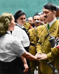 Hitler greets a member of the League of German Maidens (Bund Deutscher Mädel, abbreviated 'BDM'), the all-girls wing of the Reich's 'Hitler Youth' movement. German Women, German Girls, Nazi Propaganda, Germany Ww2, The Third Reich, World War One, Historical Photos, Wwii, Empire