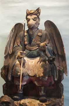 Buddhism long held that the tengu were disruptive demons and harbingers of war. Their image gradually softened, however, into one of protective, if still dangerous, spirits of the mountains and forests. Tengu are associated with the ascetic practice known as Shugendō, and they are usually depicted in the distinctive garb of its followers, the yamabushi.