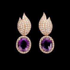 A pair of amethyst and brilliant cut diamond earrings