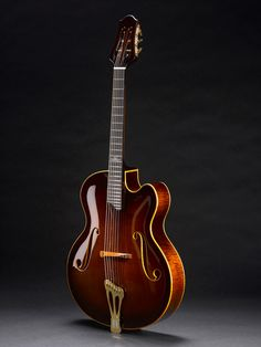 Vienna Apex archtop jazz guitar with classical-style tuners, by Theo Scharpach. Front view.