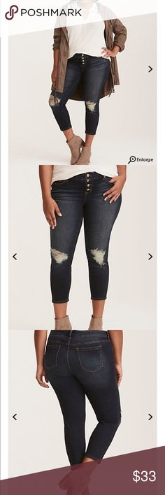 NWT torrid size 16 skinny distressed jeans NWT torrid size 16 button fly skinny distressed jeans . Might as well give up now; you're not gonna find a more flattering jean than this. The dark wash denim style is already slimming on its own, but it borders on unstoppable with a skinny-mini fit from thigh to cropped ankle. The four button fly (you read that right) causes a tummy-smoothing effect on the high rise waist, while the ripped knee destruction makes you look like a girl that craves…