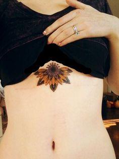 Attractive half sunflower tattoo under breast Sunflower Tattoo Sleeve, Sunflower Tattoo Shoulder, Sunflower Tattoo Small, Sunflower Tattoos, Sunflower Tattoo Design, Sunflower Mandala Tattoo, Sunflower Tattoo Meaning, Type Tattoo, Lotus Tattoo