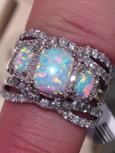 Three stone opal ring with diamond guard from Zales.