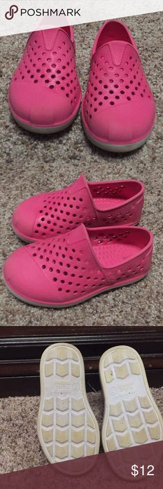 Pink Toms Romper Shoe- toddler size Water-resistant and shock absorbent with an ultrafun design, the Romper is made to withstand the rough and tumble adventures of your little one. Lightweight, soft, molded EVA fabrication. Slip-on design. This is the Toms toddler size 7 Toms Shoes Water Shoes