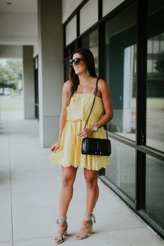 Eyelet Sundress | A Southern Drawl. Yellow eyelet little dress+grey lace-up block heel sandals+black shoulder bag+sunglasses+turquoise earrings+black sunglasses. Summer Casual Outfit 2017