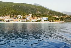 Distant view of the beautiful town of Tyros in Peloponnese Greece. On the left side of the photo, the big white building with blue windows is our hotel. White Building, Crystal Clear Water, Places To Travel, Greece, Beach, Photographs, Pictures, Windows, Beautiful