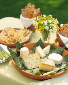 Match the informality of a summer buffet with rustic serving dishes fashioned from clay flowerpots and saucers.