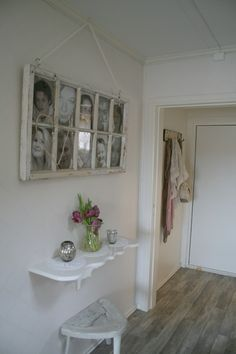 I like the use of this old window as a picture frame