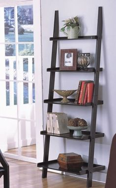 Utilize the wall space in an apartment a or small office with this sturdy black ladder shelf. The wood ladder shelf features a compact footprint to conserve floor space, while the open-frame design ma