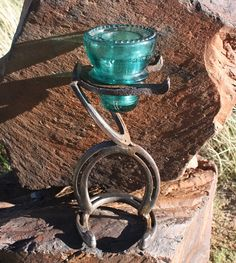 Horseshoe And Glass Insulator Candle Holder Kaitlyn....still have a few horse shoes for you