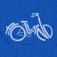"""The Stately Type Holland Bicycle t-shirt features a hand-lettered """"Holland"""" in the shape of a bicycle in white on a royal blue poly/cotton crew neck."""