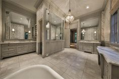 820 Eagle Pointe Montgomery, TX 77316: Photo Lavish marble-clad master suite with large walk in shower, soaking tub, incredible fixtures, his/her areas that lead to his/her customed fitted closets.