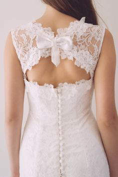 Grace Gown - The Grace gown is one memorable gown. Full lace gown with spectacular vertical button detail down back. An absolute beautiful gown for a vintage wedding. Dry Clean only.