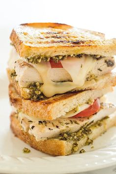 You're going to love this pesto chicken sandwich. Sourdough, toasted in olive oil and topped with grilled chicken, pesto, Swiss cheese, and fresh tomatoes.