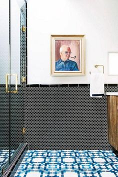 blue tiles and wall art in a bathroom
