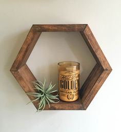 """Measurements: 12"""" height x 14"""" width x 3"""" depth This hexagon shelf can be wall mounted or free standing. Looks great alone or paired with multiple shelves!"""