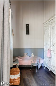 Aside from the splashes of pink, this is a child's bedroom designed to accommodate night terrors.