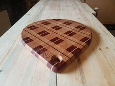 A truly unique rustic pattern and a clean modern shape make this large end grain cutting board perfect for any home! Crafted from a mixture of Maple, Cherry, and Padauk this unique cutting board is sure to catch everyones eye. Dimensions: 16-1/4 Long 13-1/4 Wide 7/8 Thick Why an end grain