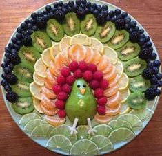 Rainbow Turkey by Jenna Getting Creative with Fruits and Vegetables: Cute Creations Salad and Fruit Choppers. This is such a cute fruit platter in the shape of an owl. Various chopped fruits make u the body of the owl. What a fun Thanksgiving Fruit Tray! Fruits Decoration, Salad Decoration Ideas, Food Decorations, Display Ideas, Thanksgiving Fruit, Thanksgiving Appetizers, Fruit Creations, Fruit Dishes, Fruit Trays
