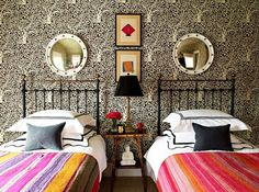 colourful twin beds and wallpaper