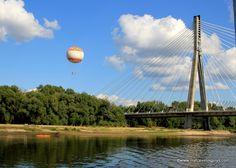 Stacja Balon and the Świętokrzyski Bridge - the first suspension bridge in Warsaw, Poland. View from the Vistula River.