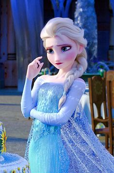 Elsa trying to make the perfect birthday cake topper for Anna on Frozen Fever