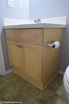 How to paint your bathroom vanity (the easy way! There& no heavy sanding or priming; just a simple few step way to get your vanity looking new and fresh! Diy Cabinets, Bathroom Cabinets, Bathroom Flooring, Bathroom Furniture, Bathroom Interior, Home Improvement Projects, Home Projects, Armoires Diy, Painted Vanity