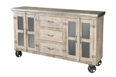 Incredibly unique the bertram sideboard features three drawers, 4 doors with glass inserts, and galvanized metal top, all on wheels.