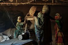 Women and flour Photo by Vicky Markolefa — National Geographic Your Shot