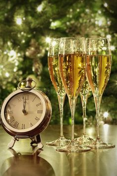 Photo about Champagne glasses, clock with lights at midnight. Image of bottle, sparkle, romantic - 47740146 Happy New Year Pictures, Happy New Year Quotes, Happy New Year Greetings, New Year Greeting Cards, New Year Wishes, Merry Christmas And Happy New Year, Christmas Time, New Years Eve Day, Happy New Years Eve