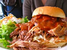 Pulled pork sandwich with curry lime BBQ sauce,