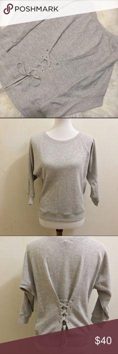 Juicy Couture Grey Lace Up Pullover Perfect sweatshirt by Juicy Couture! It has a batwing sleeve and an adorable corset style lace up design in the back! Juicy Couture Sweaters