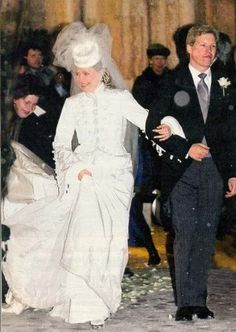 Prince Alexander of Liechtenstein and his wife Astrid Kohl were married on February 8, 2003. She did not wear a tiara. Her veil was attached to a large, white, non-brimmed woman's top hat. Her wedding dress resembled a winter coat, with wrist length long sleeves, a high neckline, and a full length skirt with a small train.