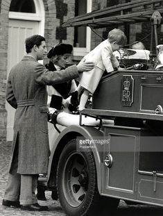 3rd January 1988, The Prince and Princess of Wales help their son Prince Harry on to a vintage fire engine at Sandringham, Norfolk