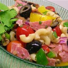 Greek Pasta Salad I ~ Pasta, mushrooms, tomatoes, red peppers, feta cheese, green onions, olives, and pepperoni marinated in a quick olive oil & vinegar dressing  #recipe
