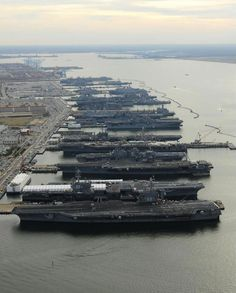 """""""It's Christmas in Norfolk! And everyone's home this year! At pier-side are USS DWIGHT D. EISENHOWER (CVN-69), USS GEORGE H.W. BUSH (CVN-77), USS ENTERPRISE (CVN 65), USS BATAAN (LHD-5), USS ABRAHAM LINCOLN (CVN-72), USS WASP (LHD-1) and USS IWO JIMA (LHD-7). And that's just the flattops! Not sure having seven carriers in one place at the same time is a good move, but it looks incredible."""""""