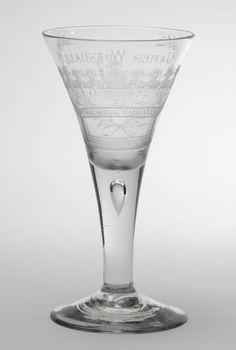 Goblet, c. 1745, possibly with later engraving. Artist/maker unknown, English. Lead-crystal glass with wheel-engraved decoration; drawn stem, Height: 8 3/8 inches (21.3 cm). Philadelphia Museum of Art, The George H. Lorimer Collection, 1953.