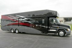 This is the way I want to travel! Motorhome with a garage, or in my case shop, where I could work from.